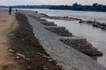 Higher Walls: This brand new 1.4 km embankment is positioned in the area where the older, lower wall breached during the devastating 2014 flood sweeping away a swath of jungle and a small Hindu temple.