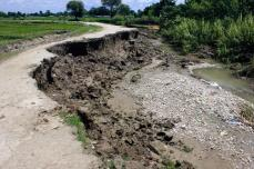 Flood Erosion: Even narrow kulos, or hand-dug irrigation channels, can become violent rivers tearing away roadbeds and fertile fields when the Karnali floods.