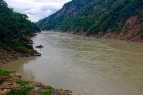 Himalayan Exit: Karnali River in the canyon at Chisapani, where river level and rainfall data is collected by a gauge reader employed by Nepal's Department of Hydrology and Meteorology. Here the Karnali River is forced through a narrow channel as it churns out of the foothills before spreading onto the Terai.